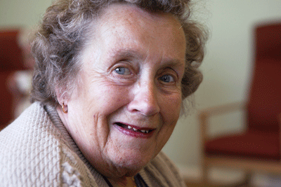Social care training courses: Older woman smiling