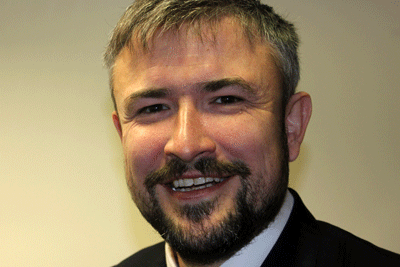 Head-shot of the author, Ewan King, SCIE's director of business development and delivery