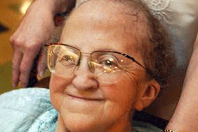 Caring safely at home: Smiling older lady